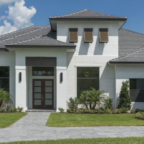 front of custom Bella Nona home