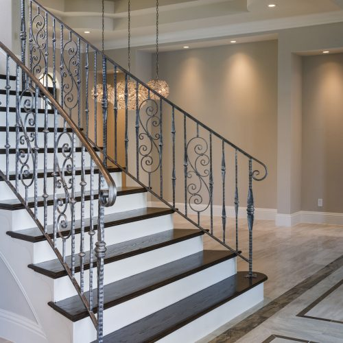 custom staircase designed and built by Beck Custom Homes