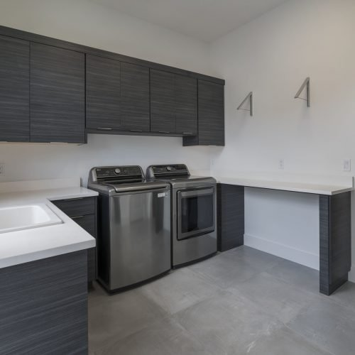 custom laundry room by Beck Custom Homes