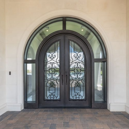 ornate custom door at new transitional style home in Orlando