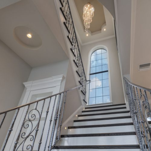 staircase at elegant transitional style home in Florida