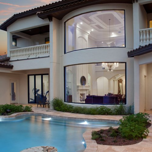 backside of luxury custom home by Beck