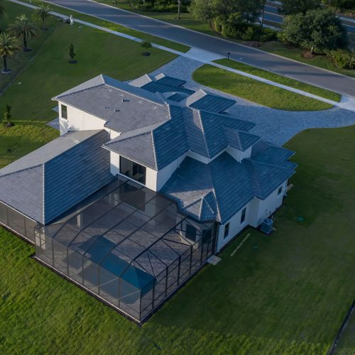 elevation of lakefront Mediterranean home by Beck Custom Homes