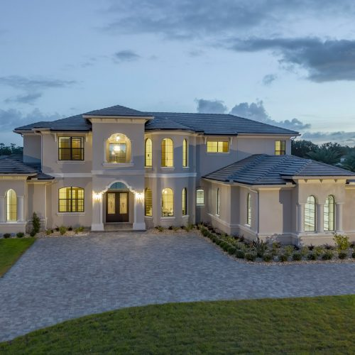 elevation of new lakefront Mediterranean style custom home