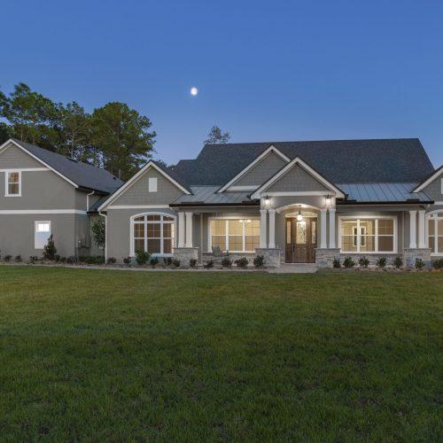 nighttime exterior shot of custom Mid Atlantic style home