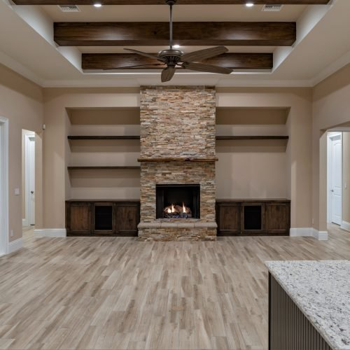 elegant interior with stone fireplace at Beck custom home in the Sanford area