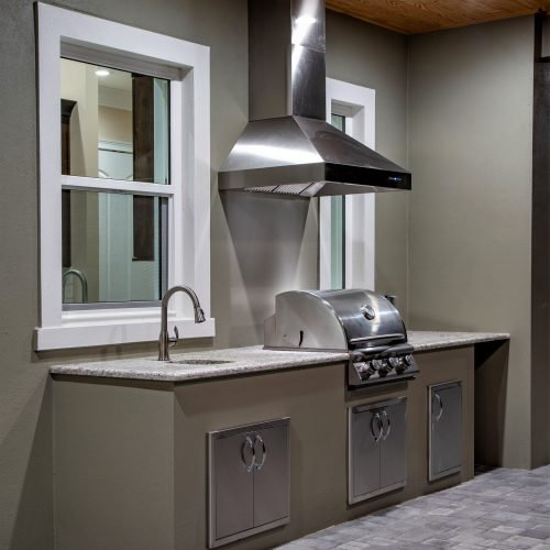 outdoor kitchen at Mid Atlantic Traditional style custom home in Sanford